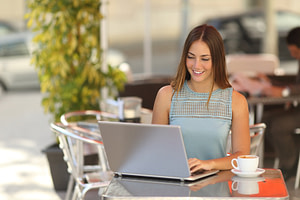 Self employed woman or student working in a restaurant